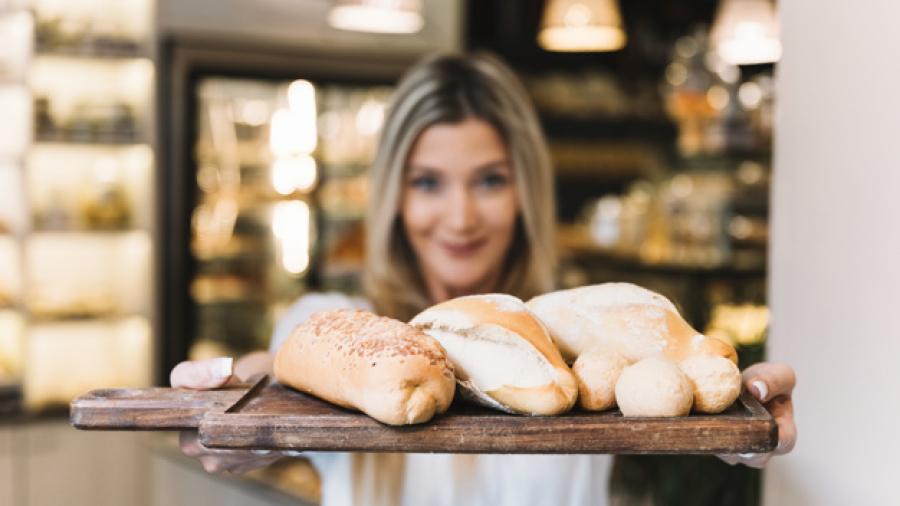 girl-offering-bread-tray_23-2147984950